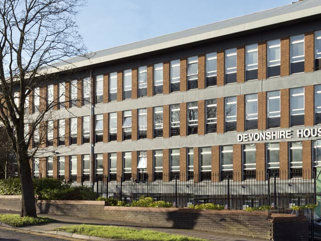 A photo of OCS's Head Office at Devonshire House Manor Way Borehamwood Herts WD6 1QQ